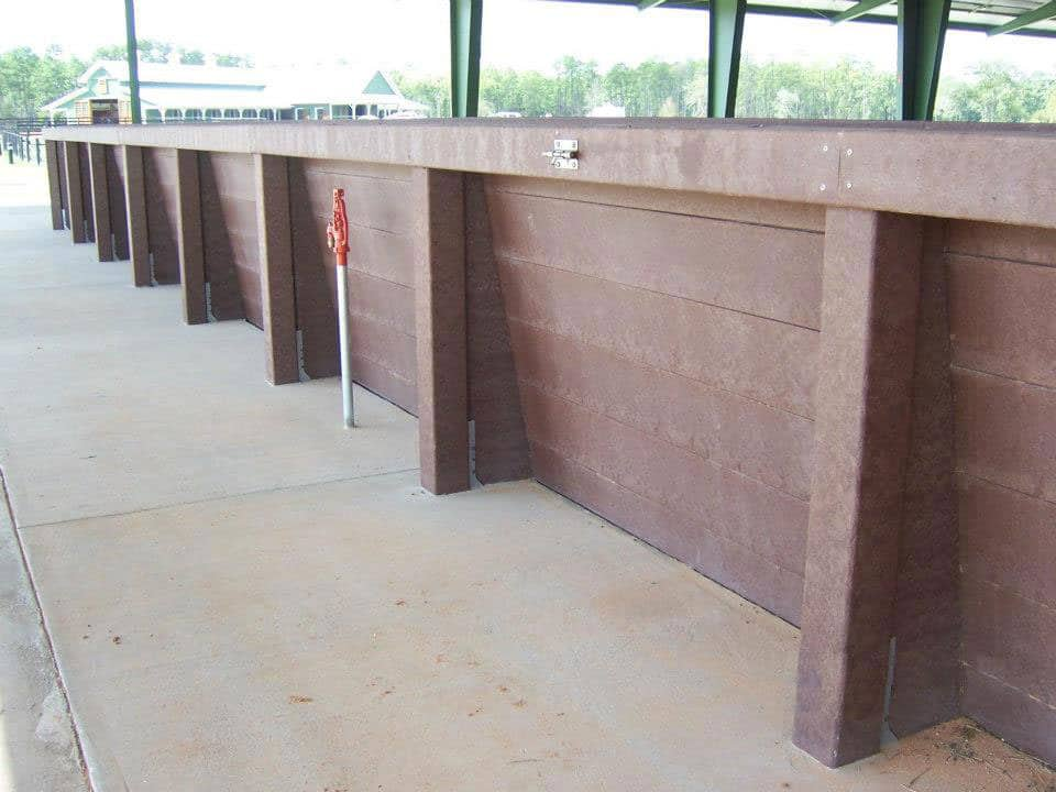 Wall of equine arena made from recycled plastic lumber