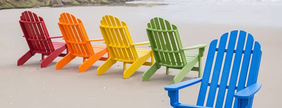 Colorful Recycled Plastic Lumber Adirondack Chairs on the beach